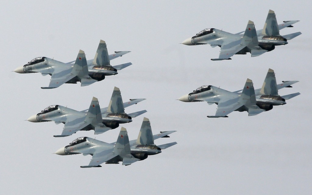 "Jet fighters from the Su-30 SM ""Sokoly Rossii"" (Falcons of Russia) aerobatic team fly in formation during the show in Krasnoyarsk, Siberia, October 25, 2014. The show is conducted as part of a recruitment drive for Russia's military divisions, targeting the youth towards contractual military service, according to organizers. REUTERS/Ilya Naymushin (RUSSIA - Tags: MILITARY SOCIETY TRANSPORT) - RTR4BK9G"