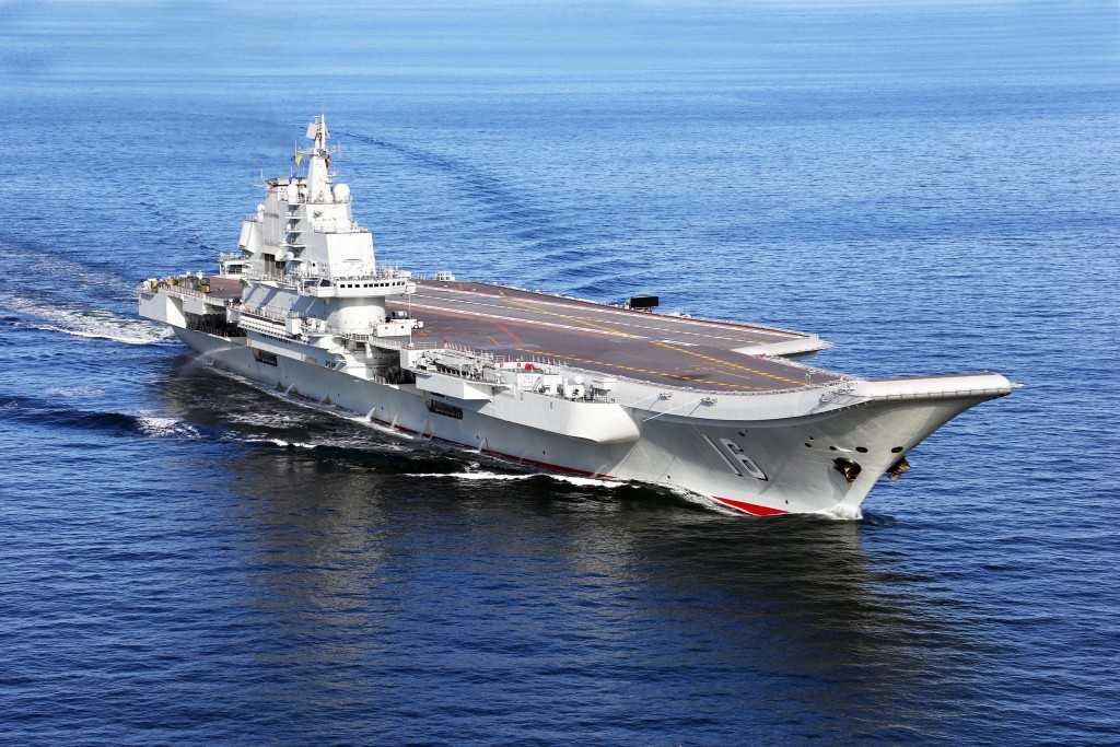 (121125) -- LIAONING AIRCRAFT CARRIER, Nov. 25, 2012 (Xinhua) --  This undated photo shows China's first aircraft carrier, the Liaoning, sailing on the sea. China has successfully conducted flight landing on its first aircraft carrier, the Liaoning. After its delivery to the People's Liberation Army (PLA) Navy on Sept. 25, the aircraft carrier has undergone a series of sailing and technological tests, including the flight of the carrier-borne J-15. Capabilities of the carrier platform and the J-15 have been tested, meeting all requirements and achieving good compatibility, the PLA Navy said. Designed by and made in China, the J-15 is able to carry multi-type anti-ship, air-to-air and air-to-ground missiles, as well as precision-guided bombs. The J-15 has comprehensive capabilities comparable to those of the Russian Su-33 jet and the U.S. F-18, military experts estimated.  (Xinhua/Zha Chunming)