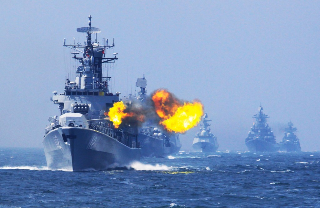 """Japanese military planes have intruded on the airspace of China-Russia naval exercises and carried out dangerous actions, seriously violating international laws, China's Ministry of National Defense said Sunday.    Two Japanese airplanes, OP3C and YS11EB, intruded into the East China Sea Air Defense Identification Zone on Saturday morning to scout and interfere with the China-Russia naval drills.     Chinese warplanes took off instantly to take necessary identification and preventive measures to ensure the safety of the warships and aircraft in the drills, said the ministry.    Japan's actions could have easily caused a misunderstanding and even led to a mid-air incident, a ministry statement said, in response to Japanese media reports that Chinese military airplanes had been """"unusually close"""" to the jets of Japan's Self-Defense Forces.    The exercises in the designated waters and airspace was a routine drill held by China and Russia. """"No fly"""" and """"no sail"""" notices in relevant waters and airspace had been issued ahead of the exercises according to international practice, the ministry said.    Chinese warplanes have the right to safeguard China's air safety and take necessary identification and preventive measures in case foreign jets enter the identification zone, it said.    China has demanded Japan to respect the legitimate rights of Chinese and Russian navies, restrain the personnel concerned and stop all reconnaissance and interference activities. """"Otherwise, Japan shall be responsible for all the consequences,"""" the statement said.    Photo: China's Harbin missile destroyer fires at a target during the China-Russia joint naval drill on East China Sea, May 24, 2014. (Xinhua/Zha Chunming)"""