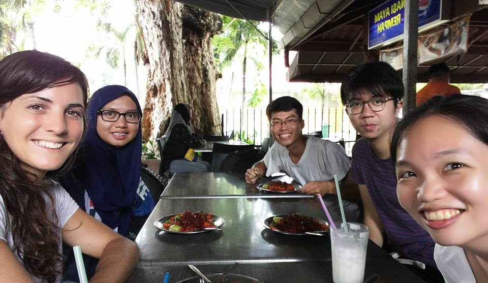 Ally Evans (far left) and Chee Suyin (far right) and team taking a well earned break during the set up of the World Harbour Project experiment in Penang.