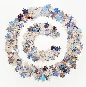 Copyright sign made of jigsaw puzzle pieces separated
